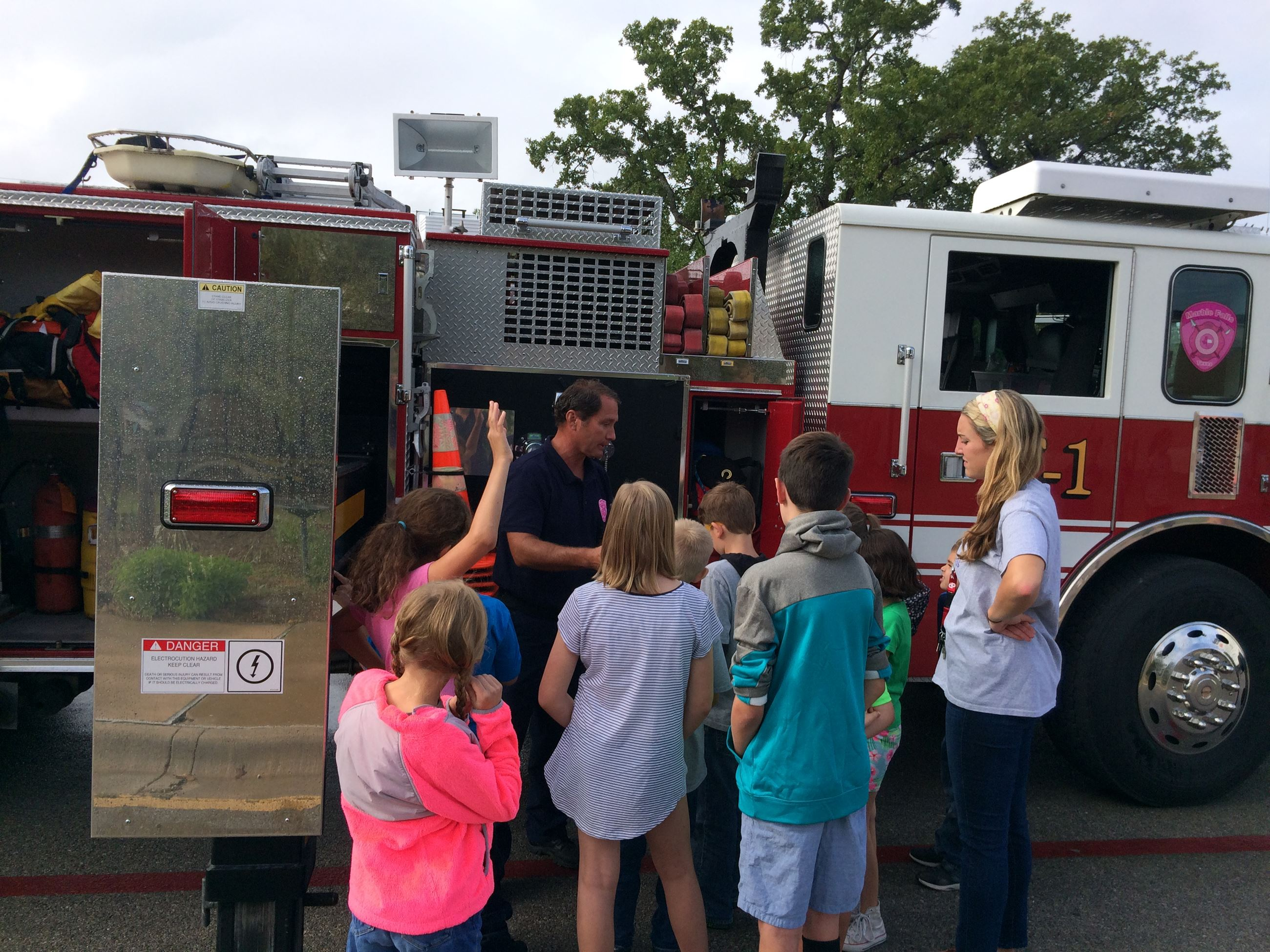 Children gather next to a fire truck